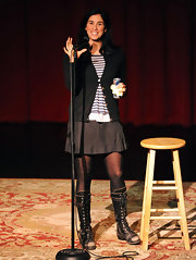 Sarah Silverman performed at OneKid OneWorld Comedy Night wearing distressed black leather lace up boots paired with black tights and a simple gray A-line skirt.