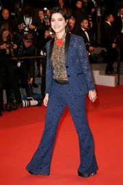 SoKo looked very '70s in a blue lace pantsuit teamed with a leopard-print blouse at the Cannes screening of 'It's Only the End of the World.'