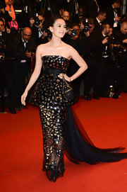 Zhang Ziyi opted for an out-of-this world number when she wore a strapless peplum dress with gold and silver embellishments all over and a midnight blue tulle train.