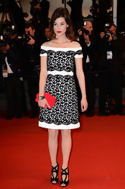 Astrid Berges Frisbey kept it super chic all the way down to her strappy black Sergio Rossi sandals.