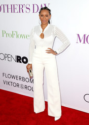 Melanie Brown showed off her ample cleavage and tiny waist in a fitted white blouse during the premiere of 'Mother's Day.'