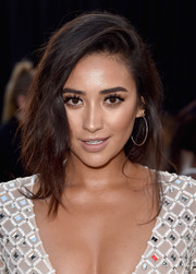 Shay Mitchell styled her hair into lovely loose braid for the premiere of 'Mother's Day.'