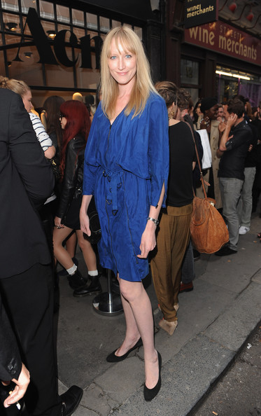 Jade Parfitt looked demure in a loose blue dress at the opening of The Acne.