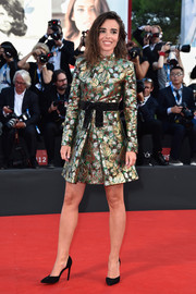 Elodie Bouchez radiated on the red carpet in a metallic brocade cocktail dress during the Venice Film Festival opening ceremony.