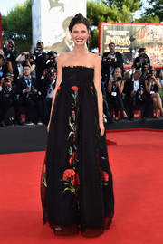 Bianca Balti charmed in a floral-embroidered, empire-waist strapless gown by Dolce & Gabbana at the Venice Film Festival opening ceremony.