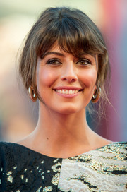 Alessandra Mastronardi swept her hair up into a simple loose updo for the Venice Film Festival opening ceremony.