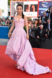 Zhao Wei glammed it up in a pink Vivienne Westwood Couture strapless gown, featuring a high-low bubble hem, at the Venice Film Festival opening ceremony.
