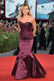 Barbara Duso got all glammed up in a strapless purple mermaid gown for the Venice Film Festival opening ceremony.