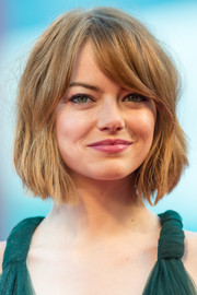 Emma Stone debuted a cute short 'do with side-swept bangs at the Venice Film Festival opening ceremony.