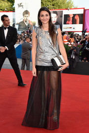 Annalisa Flori finished off her punk-chic outfit with a black-and-white gemstone-inlaid clutch.
