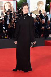 Andrea Riseborough covered up goth-style in a long-sleeve, high-neck black gown for the Venice Film Festival opening ceremony.