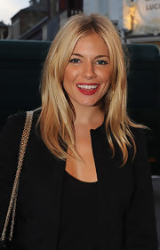 Sienna showed off her center part locks while hitting the British Film Festival.