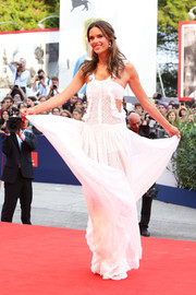 Alessandra Ambrosio stuck to her signature boho style with this white ruffle cutout dress by Philosophy when she attended the Venice Film Festival opening ceremony.