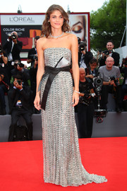 Elisa Sednaoui was a sight to behold on the Venice Film Festival red carpet in this Armani Privé stunner, a beaded silver strapless gown with an obi-style belt.