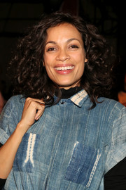 Rosario Dawson attended the Opening Ceremony fashion show sporting a head full of curls.