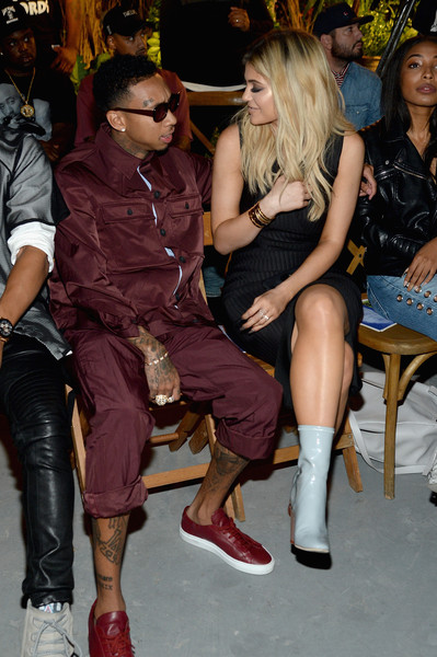 More Pics of Kylie Jenner Cross Pendant (1 of 9) - Kylie Jenner Lookbook - StyleBistro [leg,thigh,fashion,footwear,joint,event,human body,nightclub,sitting,textile,kylie jenner,tyga,front row,wall street,new york city,opening ceremony,new york fashion week,fashion show]