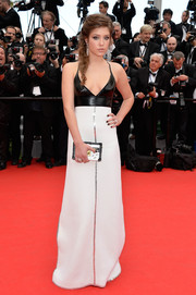 Adele Exarchopoulos vamped it up at the 'Grace of Monaco' premiere in a low-cut black-and-white Louis Vuitton halter gown featuring a plunging neckline and a pleather bodice.
