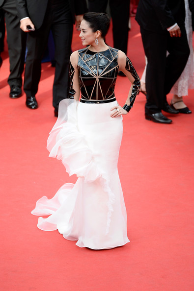 Zhang Ziyi went for edgy sophistication at the 'Grace of Monaco' premiere in a Stephane Rolland Couture gown featuring a geometric-paneled black bodice and a white ruffle skirt.