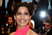 Freida's braided knotted updo gave her a young but still mature red carpet look at Cannes.