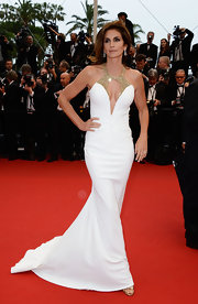 Cindy Crawford's Cannes Film Festival look consisted of this white mermaid gown that featured a gold embellished neckline.