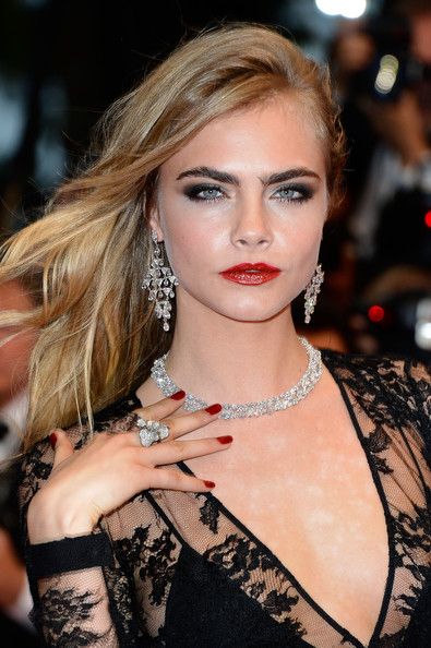 Cara Delevingne's ruby red lips gave her that instant wow-factor on the red carpet.