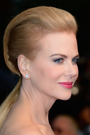 Nicole's bright pink lips gave her a flirty touch at the premiere of 'The Great Gatsby' and Cannes Film Festival.