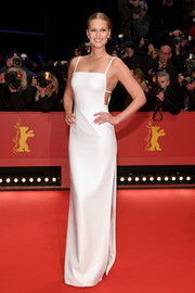 Toni Garrn proved simple can be stunning when she wore this white sequin column dress by BOSS to the Berlinale opening ceremony.