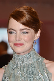 Emma Stone styled her tresses into a twisted bun for the Venice Film Festival opening ceremony.