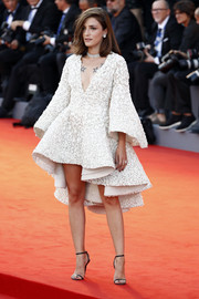 Eleonora Carisi got all dolled up in a textured white cocktail dress with a high-low ruffle hem for the Venice Film Festival opening ceremony.