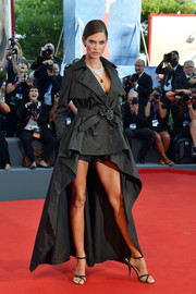 Bianca Balti was tough-glam in a black high-low trenchcoat by Jean Paul Gaultier for OVS during the Venice Film Festival opening ceremony.