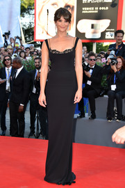 Gemma Arterton was svelte and elegant at the Venice Film Festival opening ceremony in a fitted black Stella McCartney gown with lace detail peeking from the neckline.