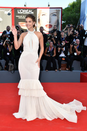 Barbara Palvin cut a shapely silhouette in a white halterneck mermaid gown by Philosophy di Lorenzo Serafini during the Venice Film Festival opening ceremony.