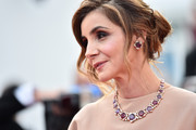 Clotilde Courau amped up the elegance with a gemstone necklace by Bulgari at the Cannes Film Festival premiere of 'La Tete Haute.'
