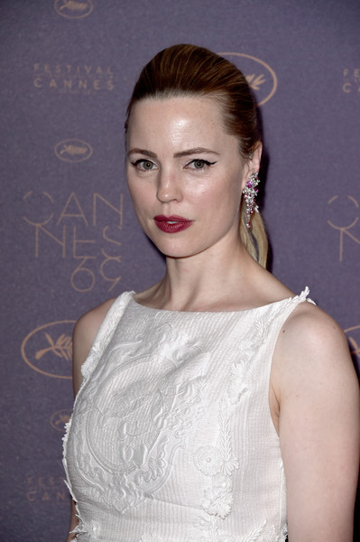 Melissa George swept her hair back into a ponytail with a teased top for the Cannes opening gala dinner.