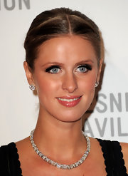 Nicky Hilton jazzed up her neckline with a sparkling diamond necklace and matching earrings.