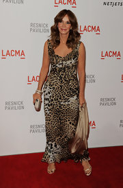 Jaclyn stunned in a floor-length leopard-print gown by Roberto Cavalli.