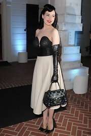 Dita Von Teese showed off her full length leather gloves while attending the store opening of Louis Vuitton in Santa Monica.