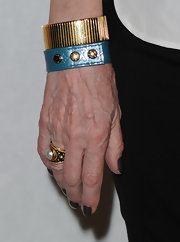 Cheryl Tiegs showed off her sleek bangle bracelet.