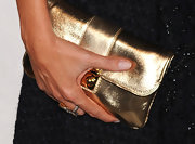 Sofia Vergara paired her navy dress with a gold metallic envelope clutch.