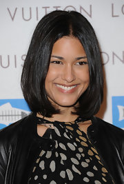 Julia Jones showed off her sleek center part locks while hitting the red carpet at the Louis Vuitton store opening.