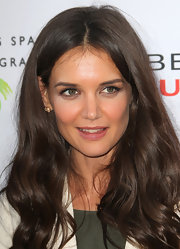 Actress Katie Holmes attended the Beauty Culture Exhibition wearing Rose Flower earrings in 18-karat rose gold and diamonds.