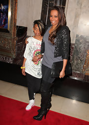 "Mel B attended the opening night of ""Cats"" with her daughter Phoenix wearing a sexy pair of over-the-knee boots. Her cropped sequin jacket and oversized clutch went perfectly with her boots, but we wish she would have picked another shirt."