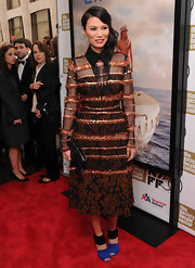 Wendi Deng matched her uber stylish dress with a pair of color-block cutout ankle boots at the 'Life of Pi' premiere.