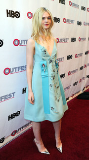 Elle Fanning went for whimsical elegance in a beaded pastel-blue A-line dress by Prada during the opening night gala of 'Tig.'