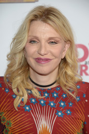 Courtney Love attended the opening of 'Hedwig and the Angry Inch' wearing her hair in mid-length curls.