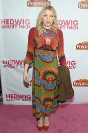 Courtney Love paired her eclectic dress with plain red pumps.