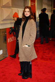 Anne Hathaway stayed warm in a brown wool coat at the Broadway opening of 'To Kill a Mockingbird.'