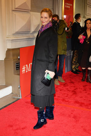 Uma Thurman completed her cold-weather attire with a pair of navy velvet boots.