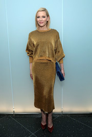 Cate Blanchett attended the opening of MoMA's Pedro Almodovar retrospective wearing a glammed-up gold sweater by Louis Vuitton.