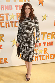 Debra Messing chose to wear this leopard print sheath dress from one of her favorite designers to the Broadway opening of 'Peter and the Starcatcher.'
